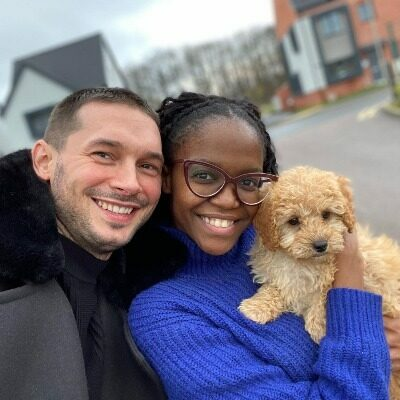 oti and her husband with their dog