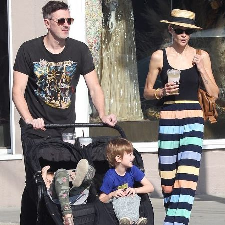 King and Kyle taking their toddlers on a stroll