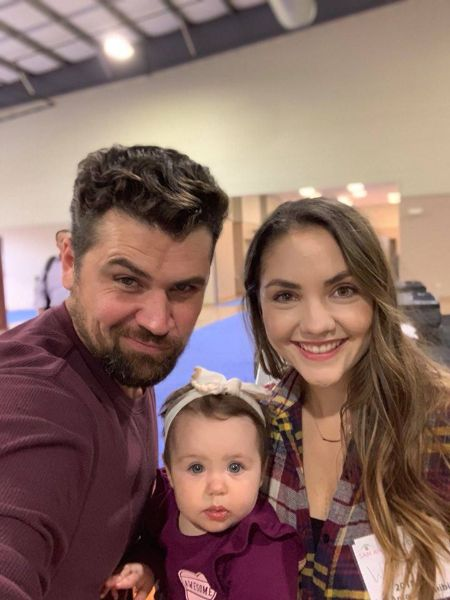Chez with his wife Whitney and their child