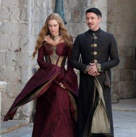 Aidan as Littlefinger in Game of Thrones alongside Lena Headey   Image Source: Digital Spy