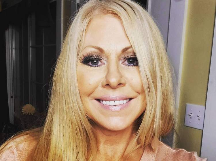 a smiling picture of Former WWE diva Terri Runnels